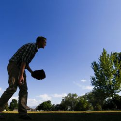 Alex Jensen plays catch with his children at Edgemont South Stake Park in Provo on Tuesday, May 30, 2017.