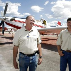 Pilot Wayne Faw, left, and New Frontier Aviation owner Andy Taylor, say fighting fires from the air is a rough ride.