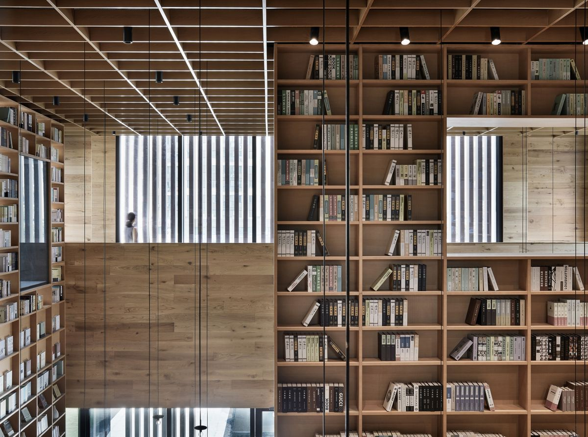 Timber bookshelves filled with books.