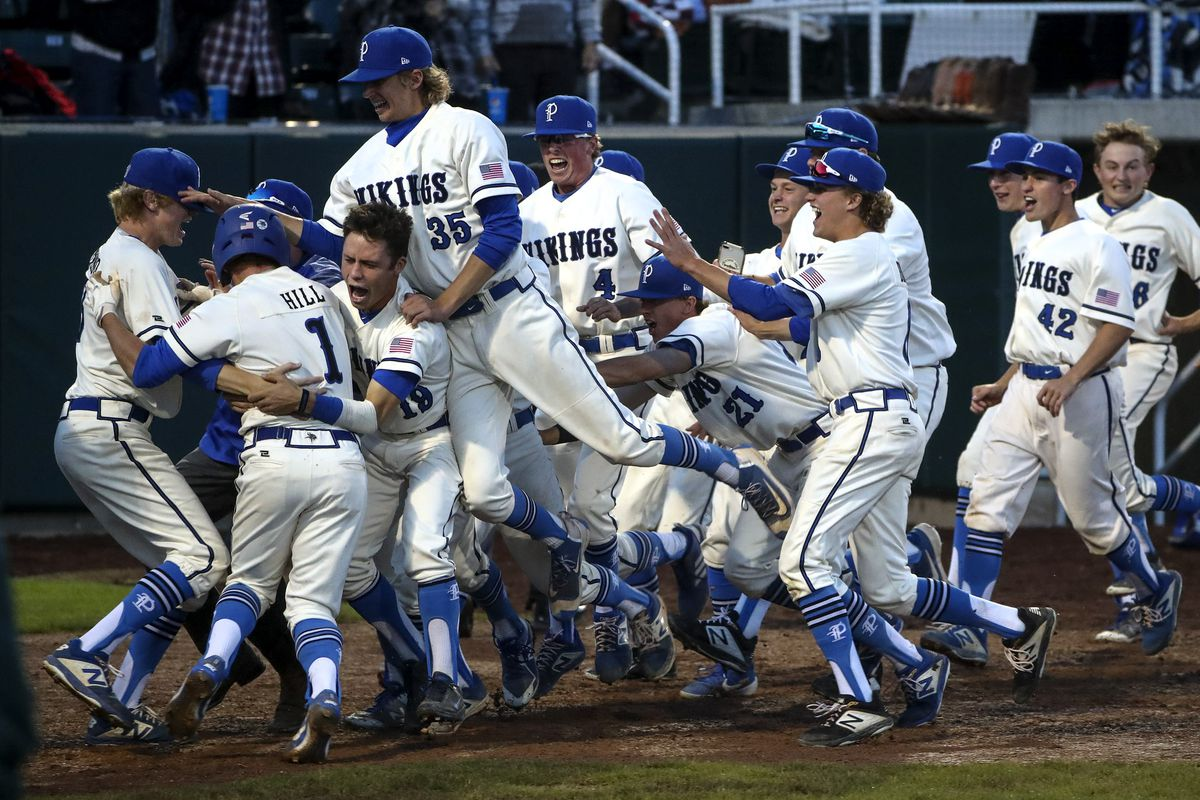 Pleasant Grove players pile onto of each other as they celebrate their victory over Lone Peak for the 6A high school baseball championship at the UCUU ball park in Orem on Friday, May 24, 2019.