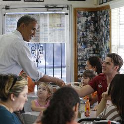 President Barack Obama greets patrons during an unannounced stop at the West Tampa Sandwich Shop and Restaurant, during an unannounced stop, Saturday, Sept. 8, 2012, in Tampa, Fla.