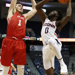 UConn's Antwoine Anderson (0) puts up a shot over a Boston University defender.