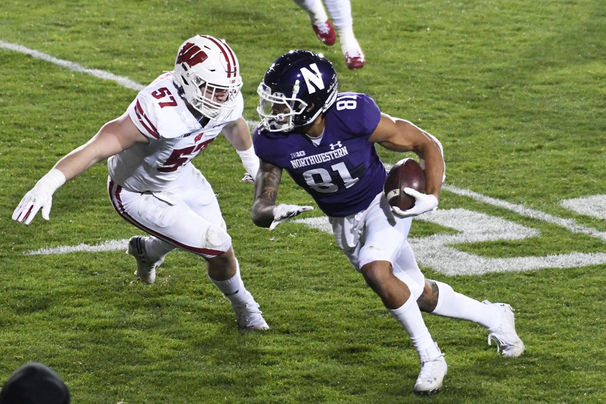 Northwestern Wildcats wide receiver Ramaud Chiaokhiao-Bowman runs as Wisconsin Badgers linebacker Jack Sanborn defends during the second half at Ryan Field.
