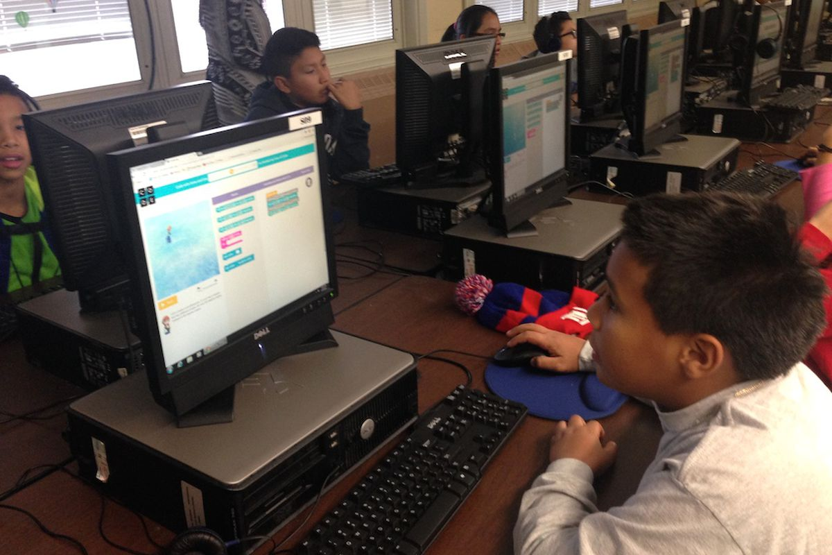 """A sixth grade class at M.S. 88 participate in an """"Hour of Coding"""" event organized by the computer science advocacy group Code.org. The city is planning to train 100 teachers on new computer science curriculum by 2017."""