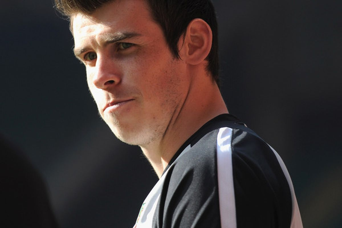 CARDIFF, WALES - MARCH 25:  Gareth Bale looks on as he sits out due to injury during the Wales training session ahead of their UEFA EURO 2012 qualifier against England on March 25, 2011 in Cardiff, Wales.  (Photo by Michael Regan/Getty Images)