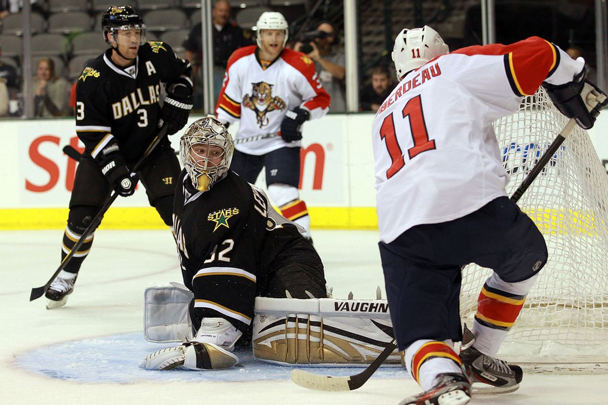 DALLAS, TX - SEPTEMBER 29:  Kari Lehtonen #32 of the Dallas Stars gives up a goal against Jonathan Huberdeau #11 of the Florida Panthers at American Airlines Center on September 29, 2011 in Dallas, Texas.  (Photo by Ronald Martinez/Getty Images)