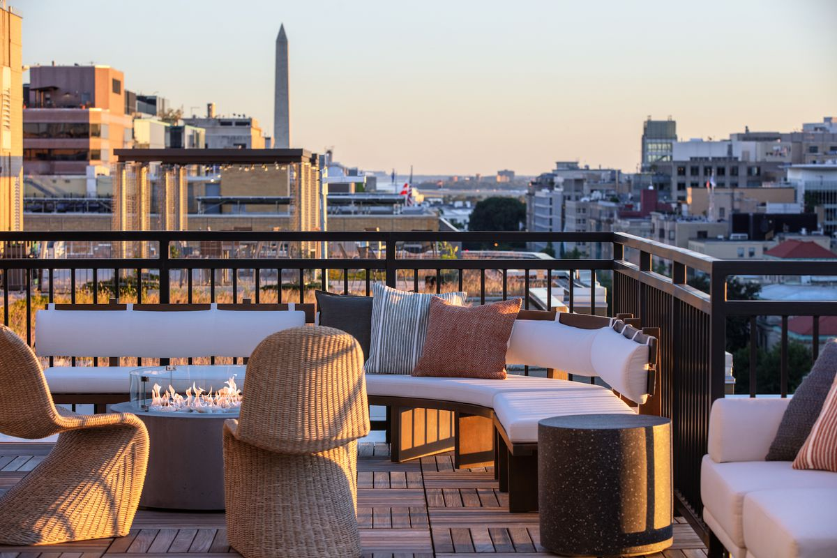 Lady Bird's patio features lounge furniture, fire pits  and views of the Washington Monument.
