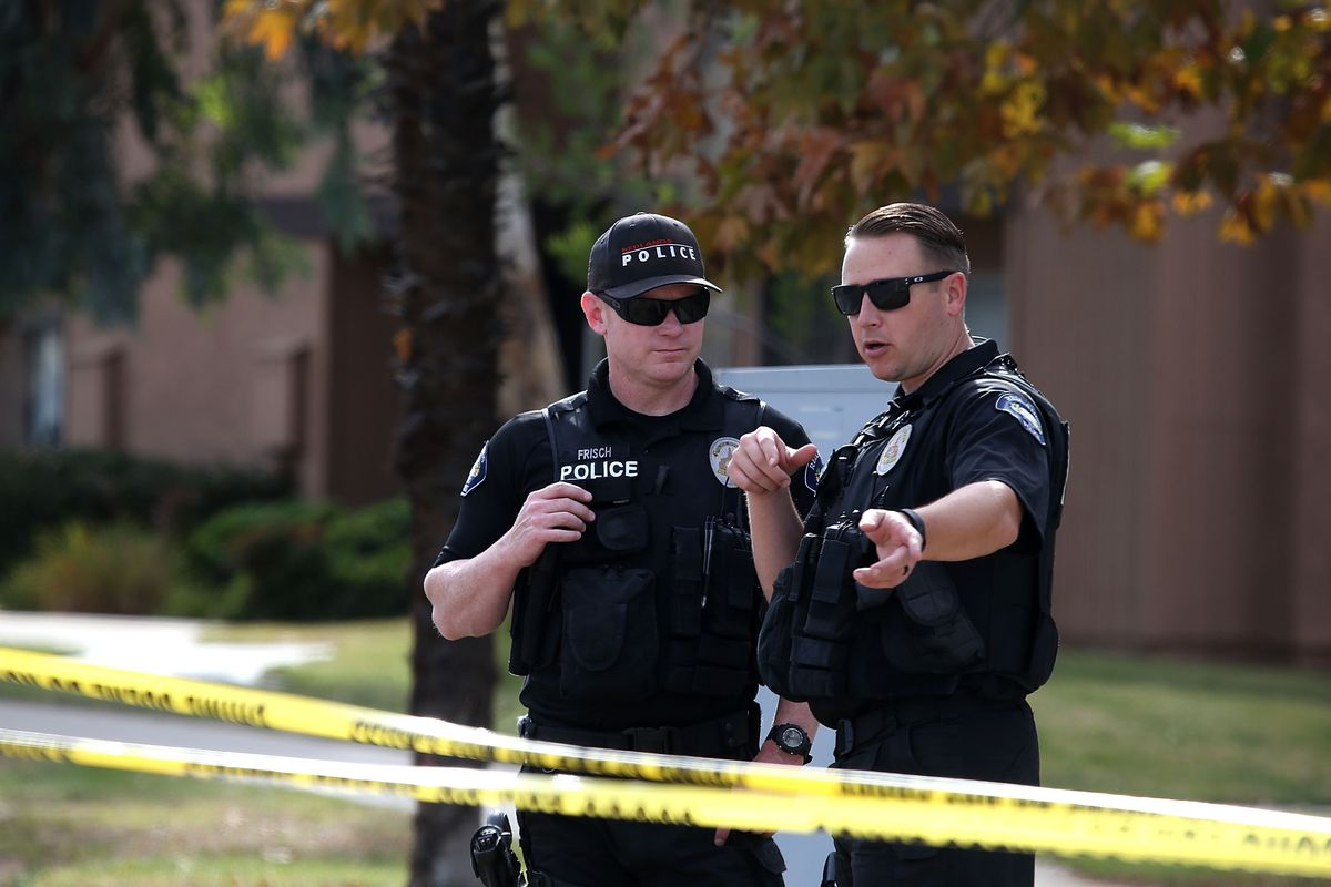 Redlands police officers stand guard as FBI investigators search the home of Syed Farook on December 3, 2015, in Redlands, California.