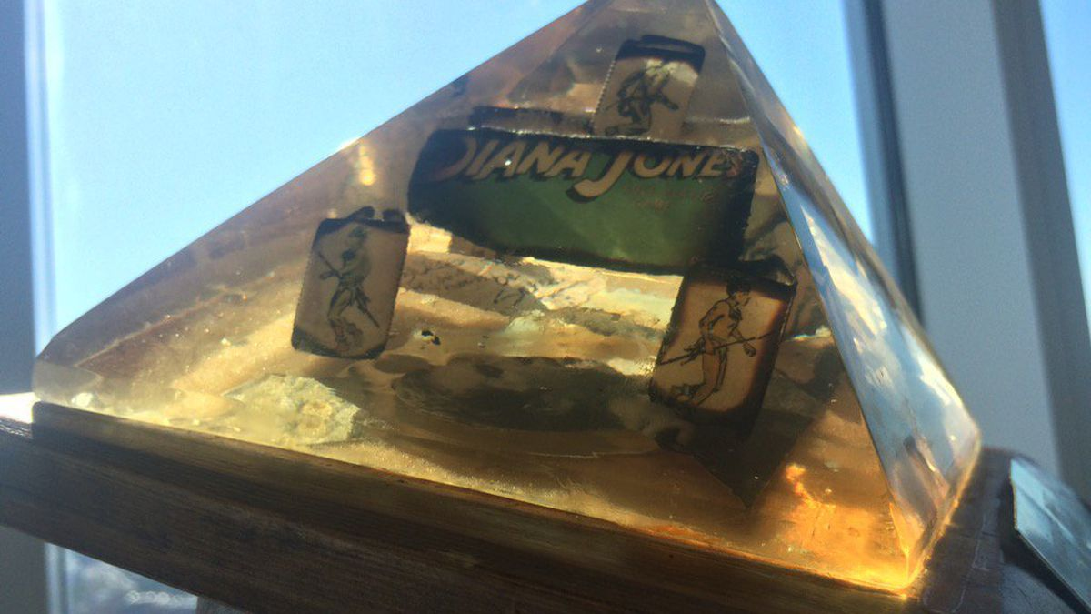 """A Perspex pyramid holding the remains of the """"last"""" copy of TSR's Indiana Jones RPG."""