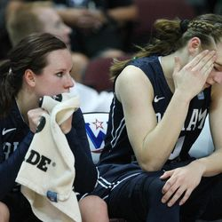 Brigham Young Cougars guard Stephanie Rovetti (10) and Brigham Young Cougars guard Lexi Eaton (21) watch the final seconds of the game during the West Coast Conference championship game in Las Vegas Tuesday, March 11, 2014. BYU lost 71-57.