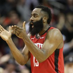 Houston Rockets guard James Harden celebrates Robert Covington's three point basket late in the second half of an NBA basketball game against the Utah Jazz, Sunday, Feb. 9, 2020, in Houston.