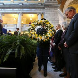 A wreath is carried into the public memorial service for former Speaker of the House Rebecca Lockhart in the Capitol rotunda in Salt Lake City on Thursday, Jan. 22, 2015. Lockhart died at her home in Provo on Jan. 17, 2015, from a rare brain disease.