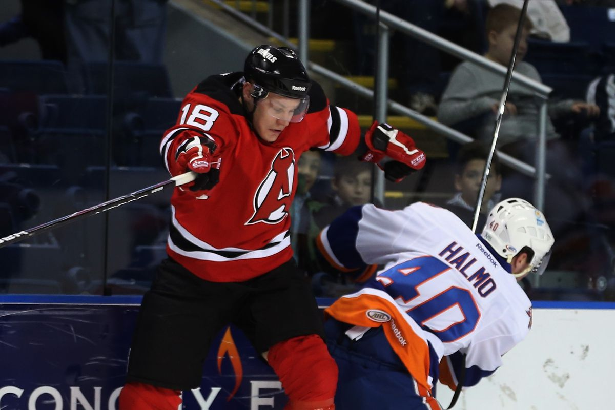 Writer K wrote about the Albany Devils. There are only Albany pictures in the photostream from their December 2012 game against Bridgeport so...here's one of those.