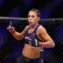 Joanna Jedrzejczyk enters the ring to defend her UFC women's strawweight title.