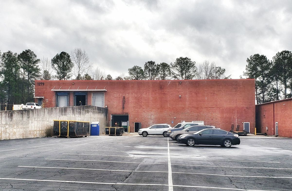 A shot of a brick building warehouse, the future home of Round Trip Brewing on Seaboard Industrial in  Underwood Hills, Atlanta