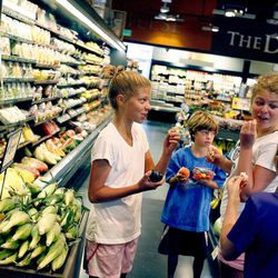 Zoe Brusa, Tate Brusa, Lane Brusa and Caroline Boyden shop at Harmons in Salt Lake City on Wednesday, Aug. 15, 2012. Local business and civic leaders unveiled a new economic study that shows spending money at local businesses can have a bigger impact on the local economy than spending at national chains.