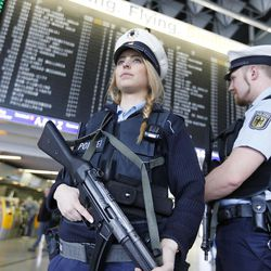 German police officers guard  a terminal of the airportthe  in Frankfurt, Germany, during tighter security measures  Tuesday, March 22, 2016, when various explosions hit the Belgian capital  Brussels killing several people.