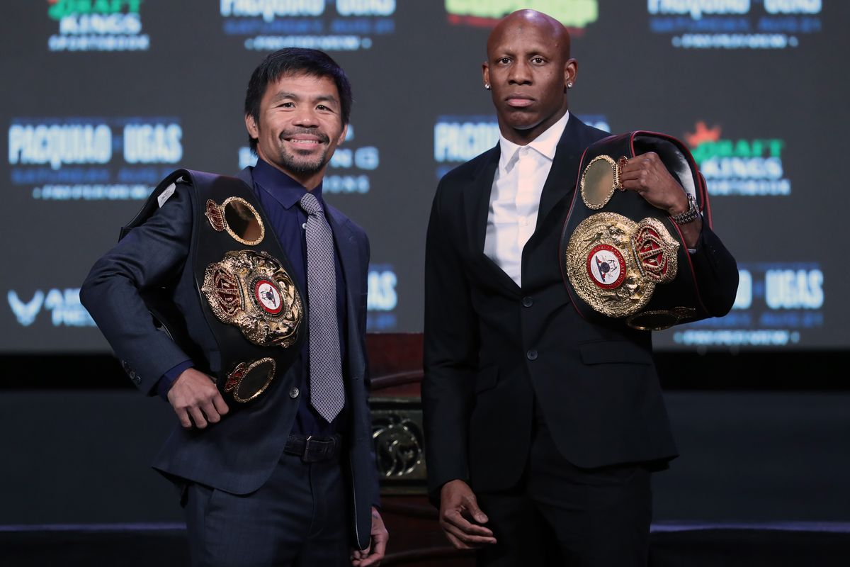 Manny Pacquiao (L) and WBA welterweight champion Yordenis Ugas pose during a news conference at MGM Grand Garden Arena on August 18, 2021 in Las Vegas, Nevada.