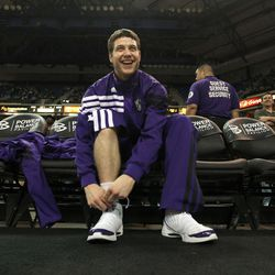 In this photo taken Wednesday, March 28, 2012, Sacramento Kings rookie guard Jimmer Fredette laces up his shoes before an   NBA basketball game against the San Antonio Spurs in Sacramento, California. Last March Jimmermania swept up the nation, now the former BYU star gets limited minutes with the Kings.