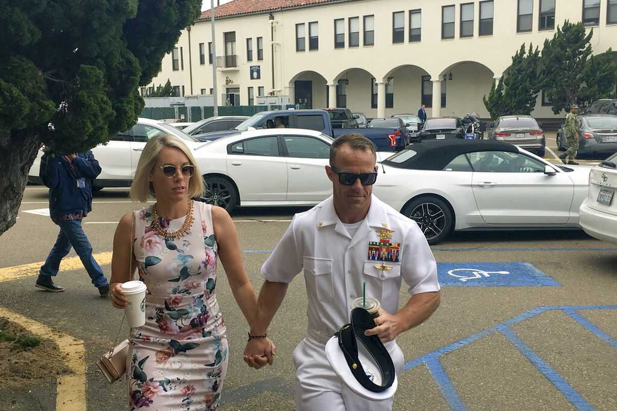 Navy Special Operations Chief Edward Gallagher and his wife Andrea walk into military court in San Diego