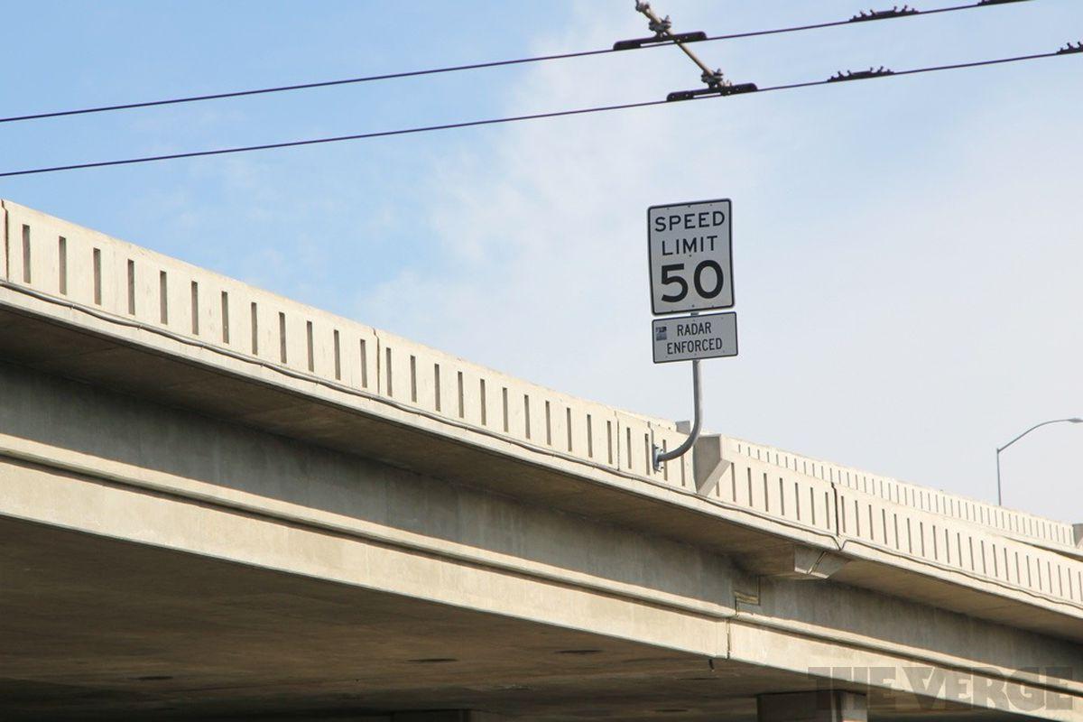 speed limit sign bridge stock 1024