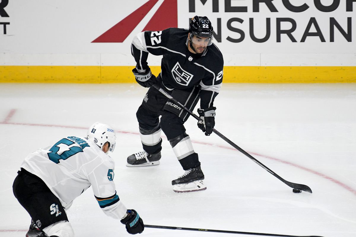 Los Angeles Kings Winger Andreas Athanasiou (22) looks to make a pass under defensive pressure from San Jose Sharks Defenceman Radim Simek (51) during an NHL game on April 02, 2021, at the Staples Center in Los Angeles, CA.