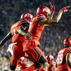 Utah Utes quarterback Tyler Huntley (1) and wide receiver Darren Carrington II (9) celebrate after Huntley ran for a touchdown, putting the Utes up 16-0 over the Brigham Young Cougars in the third quarter at LaVell Edwards Stadium in Provo on Saturday, Sept. 9, 2017.
