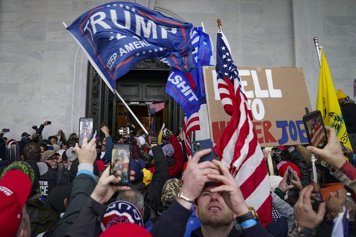 In this Jan. 6, 2021, file photo, Trump supporters gather outside the Capitol in Washington. Online supporters of Trump are scattering to smaller social media platforms, fleeing what they say is unfair treatment by Facebook, Twitter and other big tech firms looking to squelch misinformation and threats of violence.