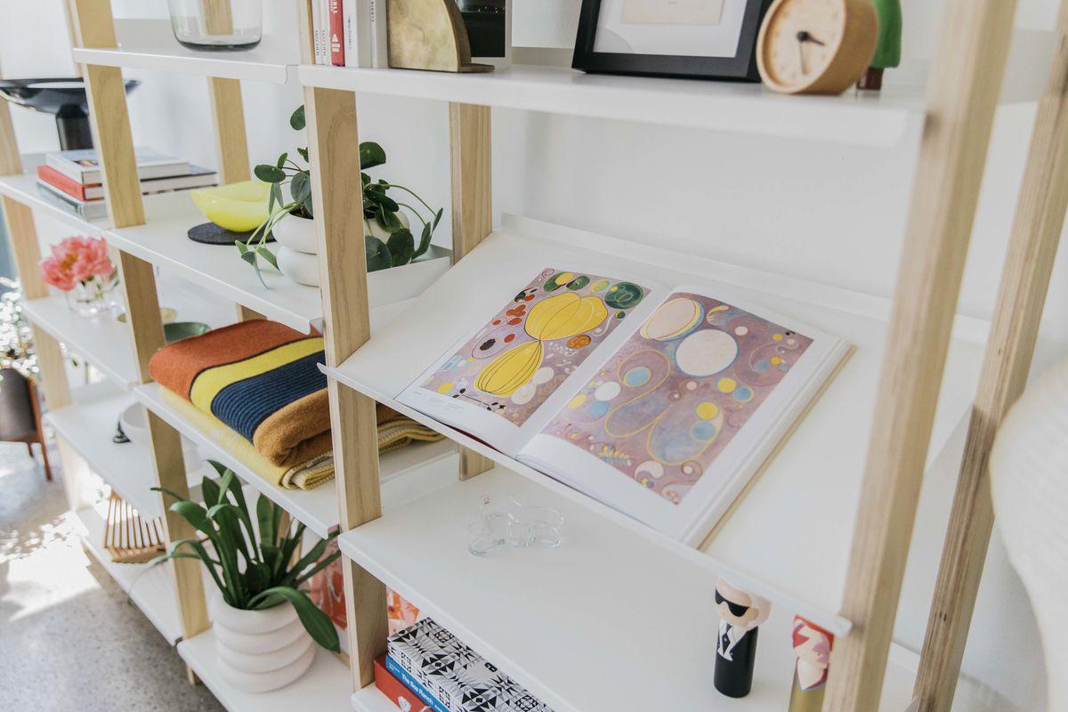 Shelves holding books and magazines