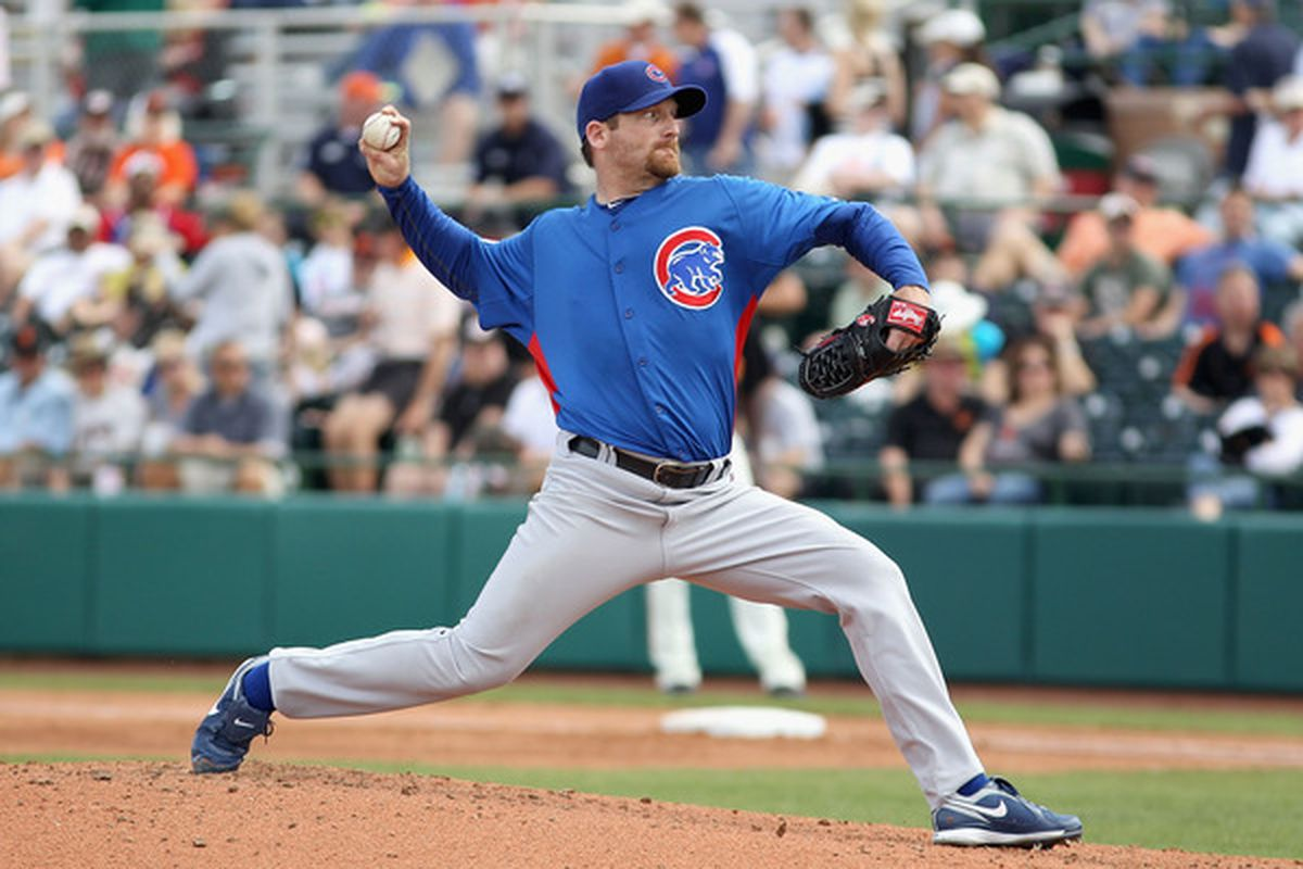 Starting pticher Ryan Dempster of the Chicago Cubs pitches against the San Francisco Giants during a spring training game at Scottsdale Stadium  in Scottsdale, Arizona.  (Photo by Christian Petersen/Getty Images)