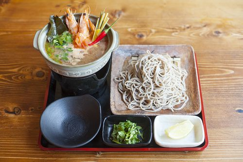 A tray with soup and soba noodles