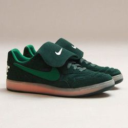 """<b>Nike</b> NSW Tiempo '94 at <b>Concepts</b>, <a href=""""http://shop.cncpts.com/products/nike-nsw-tiempo-94-pro-green-atomic-orange"""">$110</a>"""