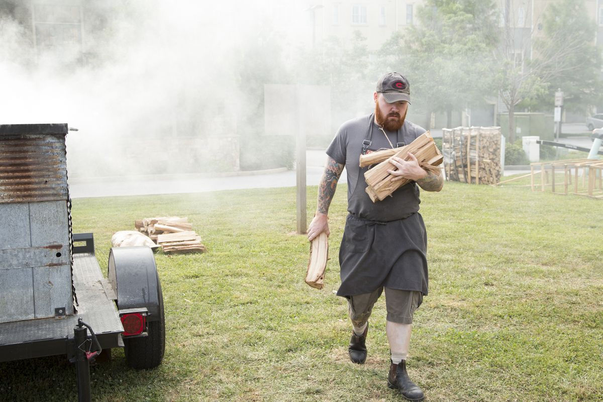 Kevin Gillespie carrying wood for a Terminus City smoker