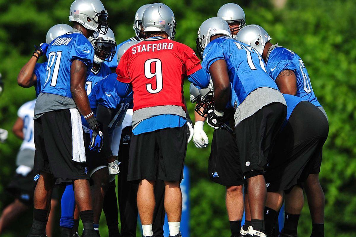 June 12, 2012; Detroit, MI, USA; Detroit Lions quarterback Matthew Stafford (9) in the huddle during mini camp at Detroit Lions training facility. Mandatory Credit: Andrew Weber-US PRESSWIRE