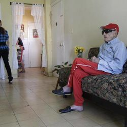 Cuban former pitcher Conrado Marrero, who once played with the Washington Senators, sits as he attends an interview with The Associated Press in Havana, Cuba, Wednesday, April 25, 2012. Marrero, who last year became the oldest living former big leaguer, turned 101 on Wednesday.