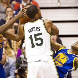 Warriors guard Jarrett Jack (2) draws a Derrick Favors (15) offensive foul during the second half of the NBA basketball game between the Utah Jazz and the Golden State Warriors at Energy Solutions Arena, Wednesday, Dec. 26, 2012.