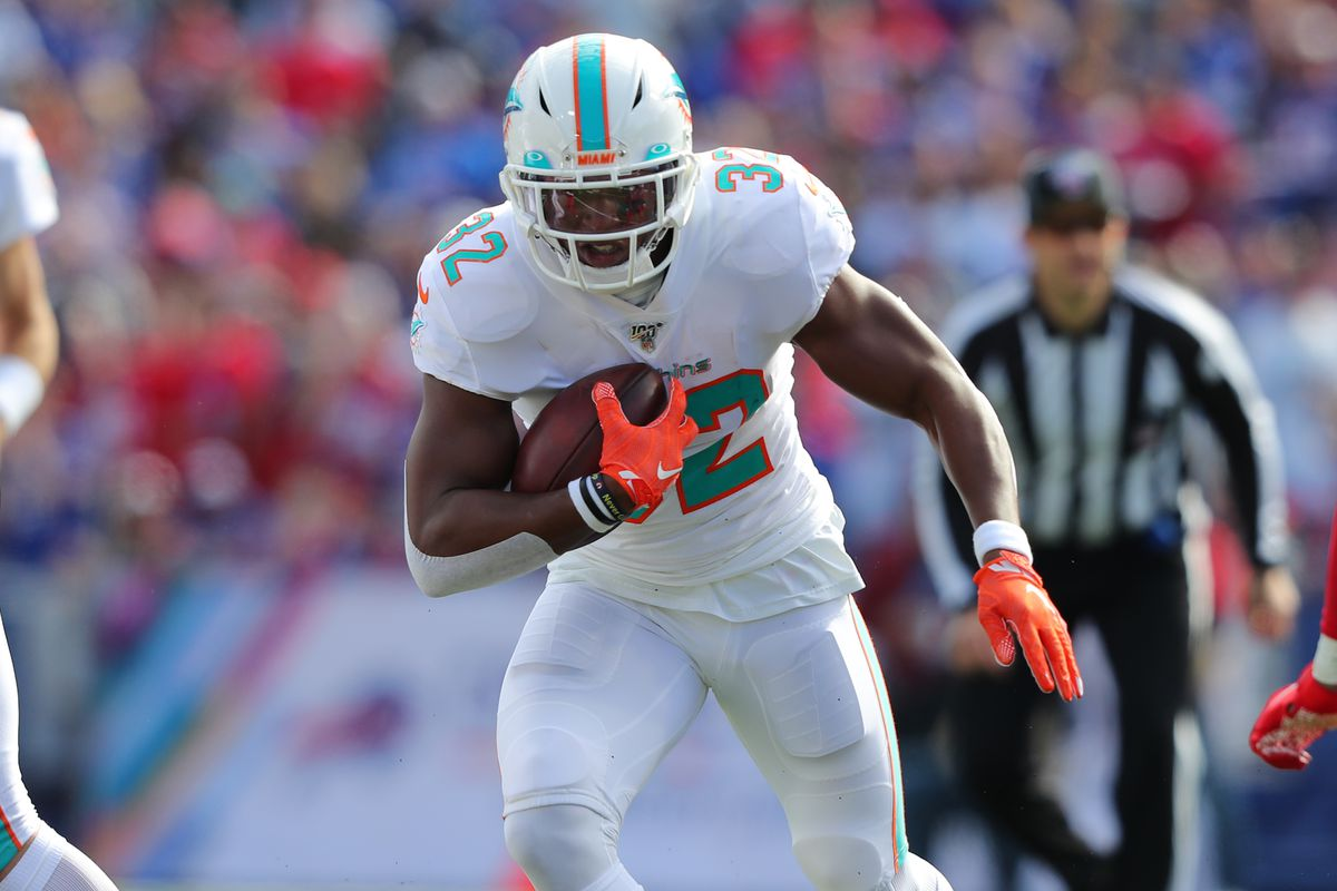Kenyan Drake of the Miami Dolphins runs the ball against the Buffalo Bills at New Era Field on October 20, 2019 in Orchard Park, New York.