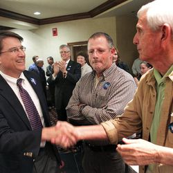 FILE - In this Feb. 1, 2012 file photo, Pat McCrory, left, greets members of the Craven County Republican Party in New Bern, N.C. McCrory's preparation for a repeat gubernatorial bid since losing to Democrat Beverly Perdue in 2008 has led to clear skies politically _ he's facing no significant primary challenge and can focus upon raising a war chest for advertising in the fall campaign.
