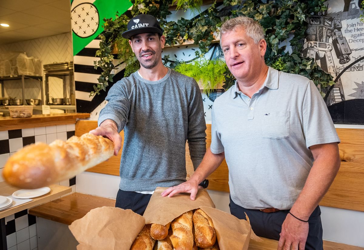 Grazie Grazie owner Casey Patten shows off the proprietary seeded loaf he developed with Gold Crust Baking Company.