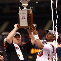 Utah head coach Kyle Whittingham and Utah quarterback Brian Johnson (3)  lift the trophy after beating Alabama winning the  2009 Allstate Sugar Bowl, at the Superdome, in New Orleans, LA. Friday Jan. 2, 2009. Photo by Scott G. Winterton/Deseret News