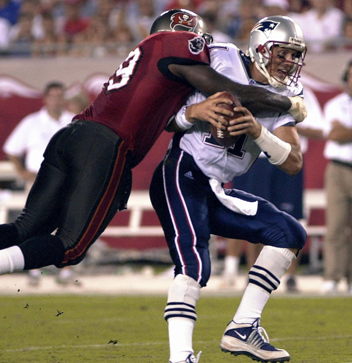New England quarterback Drew Bledsoe is sacked by