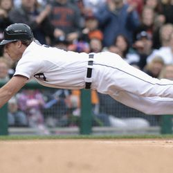 Detroit Tigers' Andy Dirks dives into third base with a triple against the Minnesota Twins in the third inning of a baseball game Saturday, Sept. 22, 2012, in Detroit.
