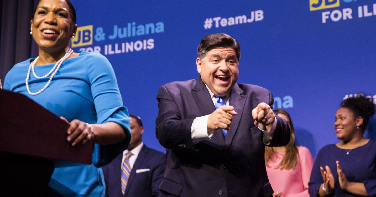 Gubernatorial candidate J.B. Pritzker and his running mate, Julianna Stratton, celebrate their win in the Democratic primary in 2018.