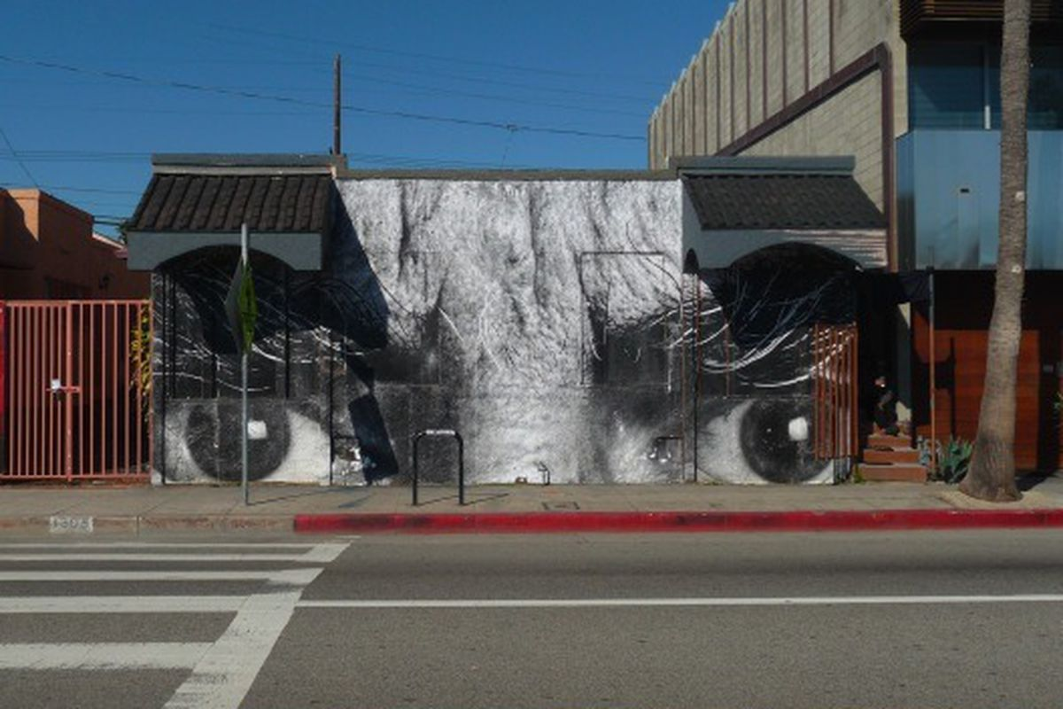 """French street artist JR (and 2011 TED prize winner) papers over a <a href=""""http://la.eater.com/archives/2011/01/14/team_gjelina_taking_over_abbot_kinney_one_resto_at_a_time.php"""">forthcoming</a> Gjelina project on Abbot Kinney."""
