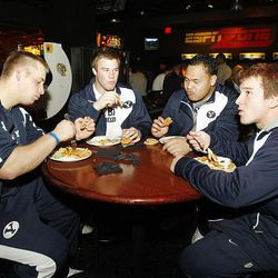 BYU football players Steve McFarland, Daniel Sorensen, Victor Unga and Tucker Lamb enjoy food from the buffet at the ESPN Zone Welcome Reception at the New York New York Hotel in Las Vegas.