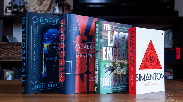 Four scifi books standing on a table