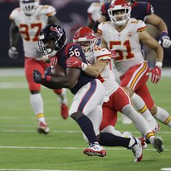 Houston Texans running back Lamar Miller (26) is hit by Kansas City Chiefs strong safety Daniel Sorensen (49) on a run during the second half of an NFL football game, Sunday, Oct. 8, 2017, in Houston. (AP Photo/David J. Phillip)