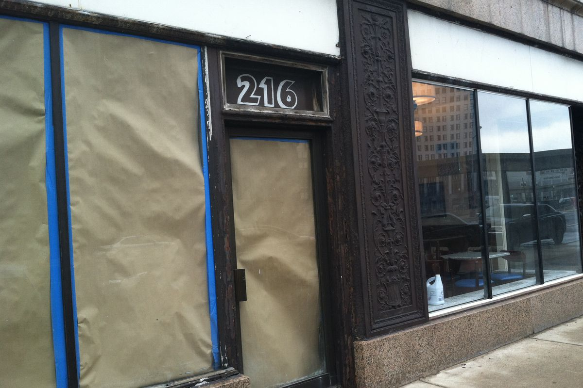 An as-of-yet unnamed bar and grill is scheduled to open in this Michigan Building storefront.