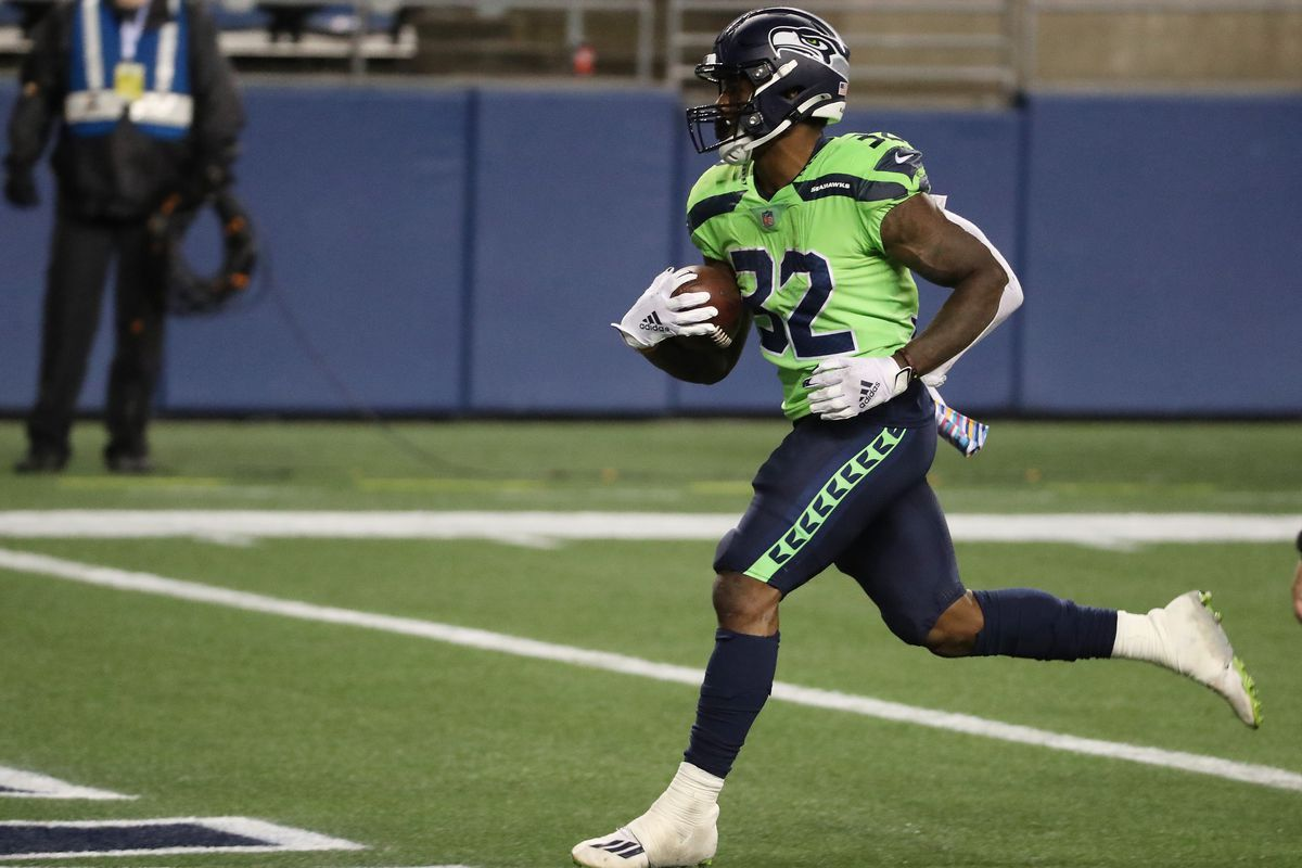Chris Carson #32 of the Seattle Seahawks scores a touchdown against the Minnesota Vikings during the third quarter at CenturyLink Field on October 11, 2020 in Seattle, Washington.