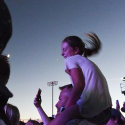 Chris Montrose bounces and dances with his granddaughter, Serenity Erickson, 9, during the Neon Trees performance at the LoveLoud Festival at Utah Valley University in Orem on Saturday, Aug. 26, 2017.